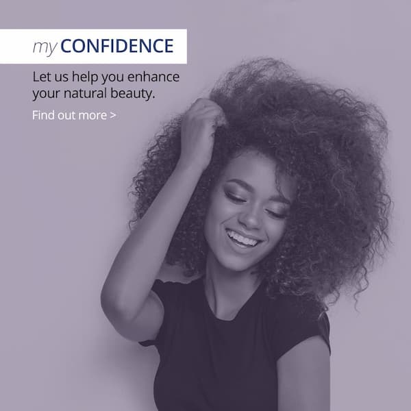 My confidence - let us help you enhance your natural beauty. Woman posing with hand in hair and smiling.