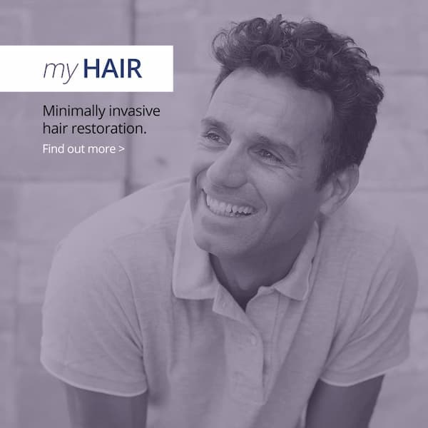 My Hair - minimally non evasive hair restoration. Man smiling and looking into the distance.